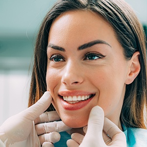 Woman's smile being examined